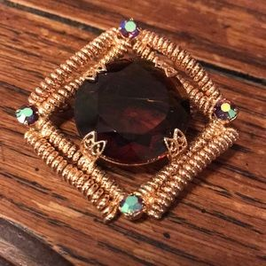 Brooch with peacock stones & unusual center stone